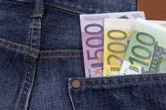 Euros (EUR) in a pocket. Euros (EUR) in a pocket of a pair of jeans. (100, 200, and 500 Euro note Royalty Free Stock Photo