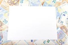 Euros. Euro banknotes with a white folio on top Background Stock Images