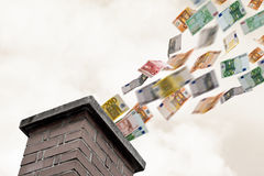 Euros flies up the chimney Stock Images