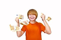 Euros flying around a boys head Royalty Free Stock Images