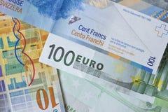 Euros, franco suizo Fotos de archivo
