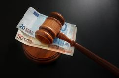 Euros and gavel Stock Photos