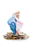 Euros growing from coin pile Stock Image