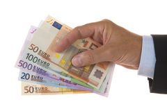 Euros in hand Stock Photo