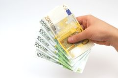Euros in hand Stock Images