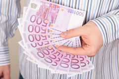 Euros in a hand Royalty Free Stock Image