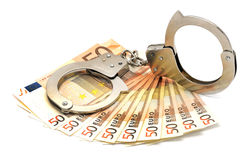 Euros and handcuffs. Euro currency notes and handcuffs - crime Stock Photos