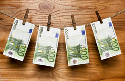 Euros hang on clothes-peg Stock Photo