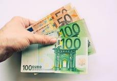 Euros humanos de la explotación agrícola de la mano foto de archivo libre de regalías