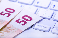 Euros on a keyboard Royalty Free Stock Images
