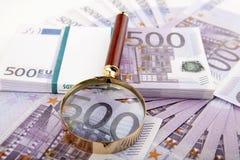 Euros with loupe Stock Image