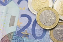 Euros money. Detailed view of euro coins lying on paper money. Background Stock Images