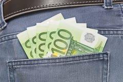 Euros no bolso das calças de brim Foto de Stock Royalty Free