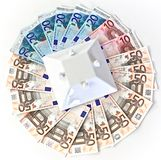 Euros notes with house roof. Euros notes of fifty, twenty and ten with house roof royalty free stock image