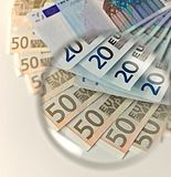 Euros notes through a magnifying lens Stock Photos