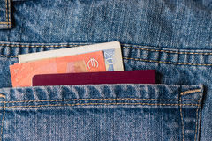 Euros and passport in jeans pocket Stock Images