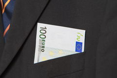 Euros in the pocket of a suit. One hundred Euros in the pocket of a suit Stock Image