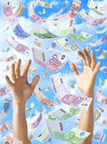 Euros Raining Falling Hands Money. Euro notes raining down or falling with a blue sky and some clouds in the background Stock Photo