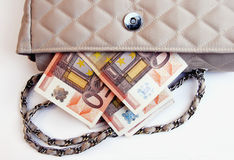 Euros sticking out of a purse Stock Photos