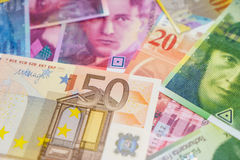 Euros and Swiss francs. Euros and Swiss franc Royalty Free Stock Images