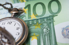 Euros time. Euro bill and retro clock time as a time is money concept Royalty Free Stock Image
