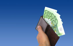 Euros in wallet. Seven hundred euros in brown wallet. Isolated object on white Stock Photos