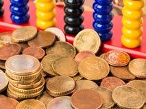 Euros y ábaco Imagen de archivo libre de regalías
