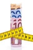 Euros y cinta métrica Imágenes de archivo libres de regalías