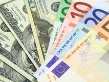 Euros y dólares Fotos de archivo