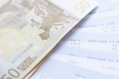 Euros y declaraciones de cuenta Fotos de archivo