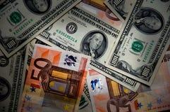 Euros y dólares Imagen de archivo libre de regalías