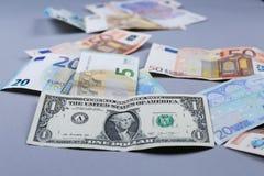 Euros y fondo americano del dólar Fotografía de archivo libre de regalías