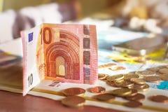 10 euros y monedas Imagen de archivo libre de regalías