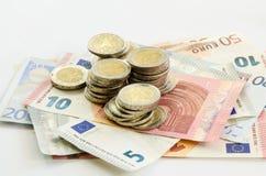 Eurosedlar och myntar Royaltyfri Bild