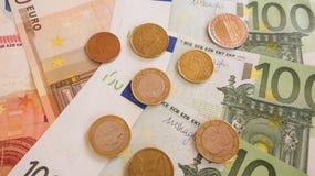Eurosedlar och myntar Royaltyfri Foto