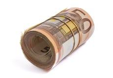 50 eurosedlar rullande och som slås in tillsammans Fotografering för Bildbyråer