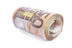 50 eurosedlar rullande och som slås in tillsammans Arkivbild
