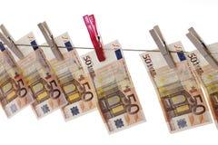 50 eurosedlar som hänger på klädstreck Fotografering för Bildbyråer