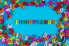 Eurovision - palavra composta de letras coloridas pequenas no fundo azul 2017 anos Fotos de Stock Royalty Free