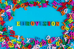Eurovision - word composed of small colored letters on blue background. 2017 year.  Royalty Free Stock Photos
