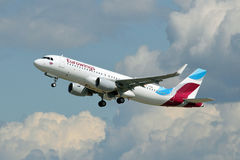 Eurowings Airbus A320-214 / D-AEWI climbs in the sky Royalty Free Stock Photography