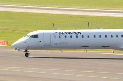 A Eurowings Bombardier CRJ900 -  cockpit. A Eurowings Bombardier CRJ900 taxiing at Düsseldorf Airport Stock Photos