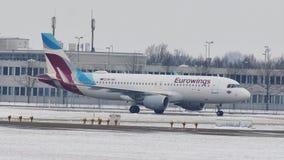 Eurowings Airbus doing taxi on Munich Airport runway. Eurowings plane landed on runway, snowy runways stock video footage