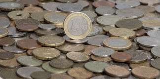 Eurozone euro on background of many old coins Royalty Free Stock Image