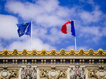 Eurpoean Union and the French flag on top of the Palace Garnier Stock Photography