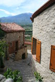 Eus, France. A street with a view. A backstreet in the pretty village of Eus with a view of the Pic du Canigou stock photos