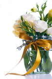 Eustoma flowers in a glass jar Stock Photos