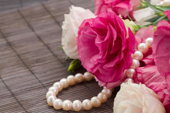 Eustoma flowers and pearls Stock Images