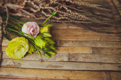 Eustoma and rose  lying on a wooden board Royalty Free Stock Photos
