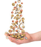Euzro coins falling in open hand. Euro coins money rain falling in open hand isolated on white background financial business success concept Stock Photo